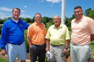 Wenham CC Head Pro Darrin Chin-Aelong (far right) and Assistant Pro Jason Greene (second from left) recently played 100 holes for charity. Also pictured are WCC members Steve McCulloch and Ralph Brown, who served as their caddies.